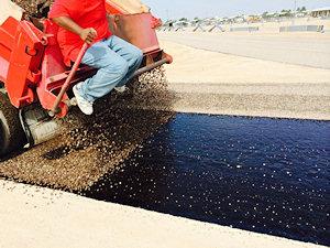 Tar & chipsealing, provides a beautiful alternative to asphalt, with the look and feel of a country gravel road.
